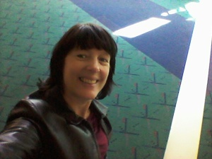 The geek selfie -- me with the about-to-be-replaced carpet at PDX